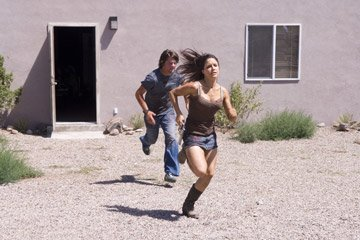 Sophia Bush and Zachary Knighton in Rogue Pictures' The Hitcher