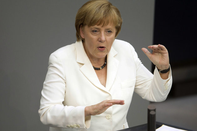 German Chancellor Angela Merkel addresses lawmakers on the decisions of the EU summit at the parliament Bundestag in Berlin, Friday, June 29, 2012. Chancellor Merkel faces a vote on the eurozone's new permanent rescue fund and the EU's fiscal pact. (AP Photo/Markus Schreiber)