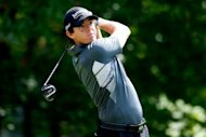 Rory McIlroy of Northern Ireland tees off from the fourth hole during the second round of the Deutsche Bank Championship at TPC Boston in Norton, Massachusetts. McIlroy fired his second straight six-under 65 on Saturday to take the early second-round lead in the Deutsche Bank Championship