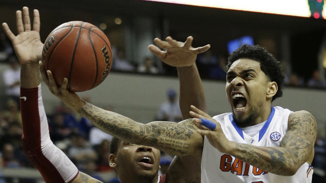 Florida guard Mike Rosario (3) shoots over Alabama forward Nick Jacobs (15) during the second half of an NCAA college basketball game in the semifinals of the Southeastern Conference tournament, Saturday, March 16, 2013, in Nashville, Tenn. (AP Photo/John Bazemore)