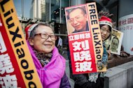 Supporters of Liu Xiaobo stage a protest in Hong Kong last December. Liu Hui's brother, Liu Tong, said he refused to believe government promises that his family was not being targeted because of Liu Xiaobo's political activism, which earned the dissident a Nobel Peace Prize in 2010