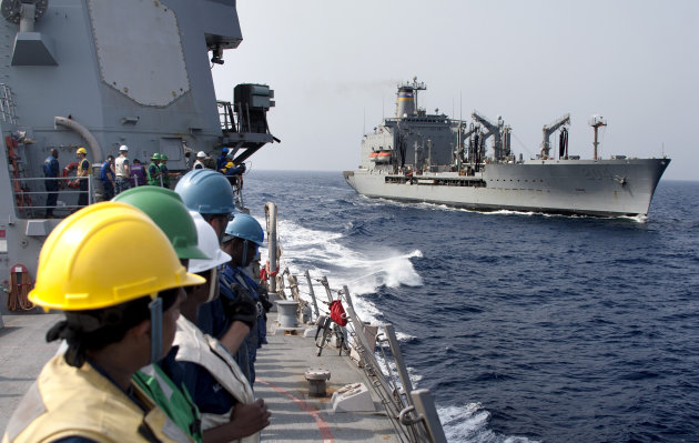 In photo released by the U.S. Navy dated June 19, 2012, the USNS Rappahannock, right, is seen by the sailors assigned to the guided-missile destroyer USS James E. Williams after completing a replenishment at Red Sea. An Indian fisherman aboard a boat shot at by the U.S. Navy off Dubai's coast has told officials the crew received no warning before being fired upon, India's ambassador to the United Arab Emirates said Tuesday, July 17, 2012. One Indian was killed in the incident, and three of his countrymen were seriously wounded. The shooting happened Monday afternoon when a small boat rapidly approached the refueling ship USNS Rappahannock about 10 miles (15 kilometers) off Dubai's Jebel Ali port, according to the Navy. (AP Photo/MC3 Daniel Meshel, U.S. Navy)