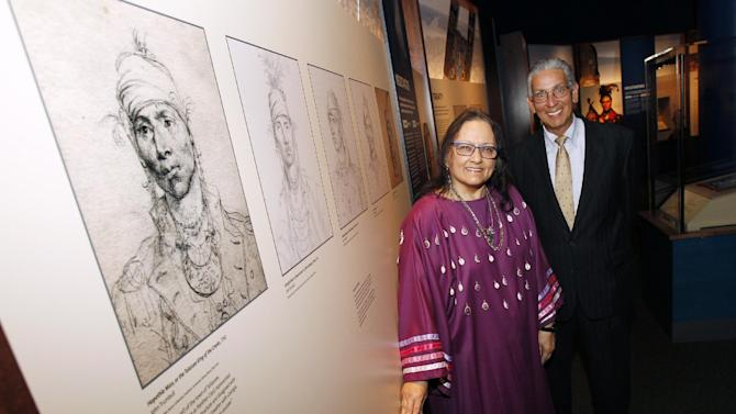 IMAGE DISTRIBUTED FOR THE SMITHSONIAN'S NATIONAL MUSEUM OF THE AMERICAN INDIAN - Guest Curator Suzan Shown Harjo (Cheyenne and Hodulgee Muscogee) and Director Kevin Gover (Pawnee) pose for a photo next to artist John Trumbull's 1790 portrait of Hopothle Mico, The Talassee King of the Creeks, at the Smithsonian Institution's National Museum of the American Indian's latest exhibition, Nation to Nation: Treaties Between the United States and American Indian Nations, on Tuesday, Sept. 16, 2014 in Washington. The exhibition opens to the public at the National Museum of the American Indian on Sunday, Sept. 21, 2014. (Paul Morigi/AP Images for The Smithsonian's National Museum of the American Indian)
