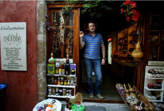 Paraskevas Christoforakis stands by his shop inside the medieval castle of Monemvasia