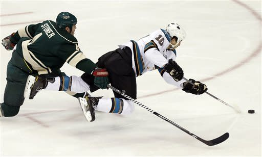 Backstrom, Suter lead Wild past Sharks 2-0