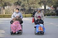 &lt;p&gt;Two elderly people are seen on their wheelchairs at a park in Beijing, on December 11, 2012. China&#39;s elderly face increasing uncertainty three decades since the one-child policy took hold, with no real social safety net, the law has left four grandparents and two parents with one caretaker for old age -- and bereaved families with none.&lt;/p&gt;
