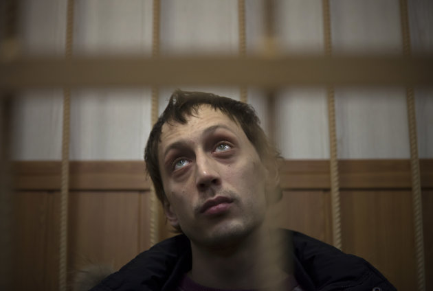 Bolshoi soloist Pavel Dmitrichenko listens in a courtroom in Moscow, Russia, Thursday, March 7, 2013. The star dancer accused of masterminding the attack on the Bolshoi ballet chief acknowledged Thursday that he gave the go-ahead for the attack, but said he did not order anyone to throw acid on the artistic director&#39;s face. Dmitrichenko told a Moscow court that he had complained about ballet chief Sergei Filin to an acquaintance, who offered to &quot;beat him up.&quot; (AP Photo/Alexander Zemlianichenko)