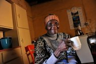 "Selina Mpisi, a feisty centenarian nicknamed ""Lady Alex"", sits in her home in the Alexandra township of Johannesburg. Modern Alexandra is a far cry from the rural expanse that greeted Mpisi when she arrived 74 years ago"