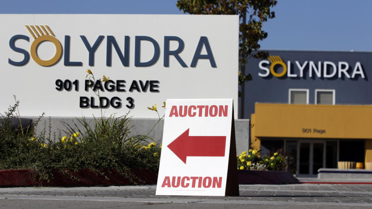 "FILE - This Monday, Oct. 31, 2011 file photo shows an auction sign at the bankrupt Solyndra headquarters in Fremont, Calif. before an auction. The bankrupt solar company Solyndra has become a rallying point for conservatives who hold up the California firm as a symbol of the Obama administration's failed economic policies. Now hundreds of glass rods custom made for Solyndra solar panels have found new life as an art installation at the University of California, Berkeley. But like all things associated with Solyndra, the ""SOL Grotto"" exhibit has become a political target this election season. (AP Photo/Paul Sakuma, File)"
