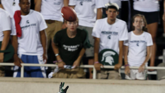 Boise State's Matt Miller (2) catches a pass for a 40-yard reception against Michigan State's Johnny Adams (5) during the second quarter of an NCAA college football game, Friday, Aug. 31, 2012, in East Lansing, Mich. (AP Photo/Al Goldis)