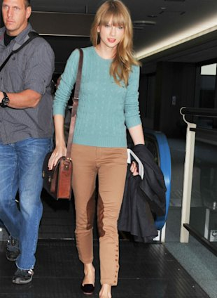 Taylor Swift Is Airport Chic In Camel Jodhpurs In Japan, Get The Look