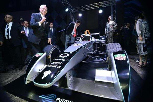 Malaysian Prime Minister Najib Razak (third from left) and other guests take a look at the newly launched Electric F1 car which can run at a maximum speed of 225 kilometers per hour, in Putrajaya of M