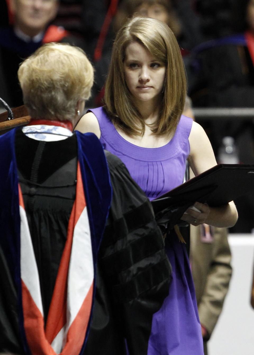 Michelle Downs Whatley accepts the degree from the University of Alabama on behalf of her sister Danielle Downs on Saturday, Aug. 6, 2011, in Tuscaloosa, Ala. Danielle lost her life when a tornado ripped through Tuscaloosa on April 27, 2011. (AP Photo/Butch Dill)