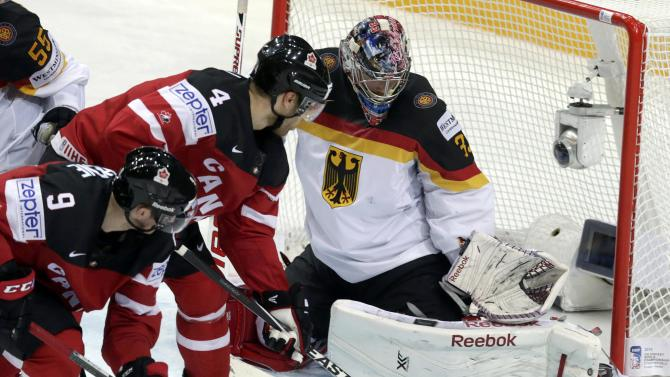 Germany's goaltender Aus der Birken defends against Canada's Duchene and Hall during their Ice Hockey World Championship game at the O2 arena in Prague
