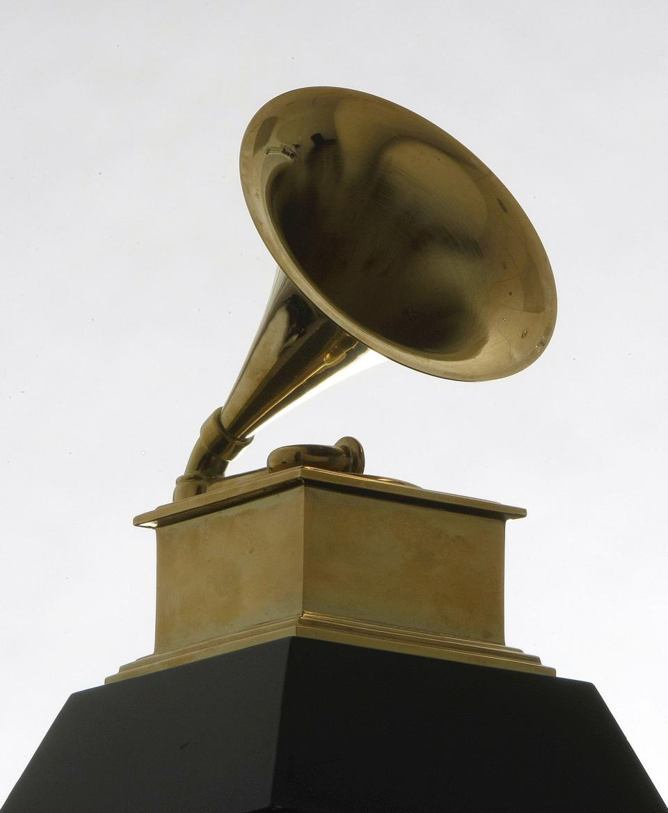 FILE - In this Dec. 9, 2008 file photo, a Grammy Award statue is photographed. (AP Photo/Charles Rex Arbogast, File)