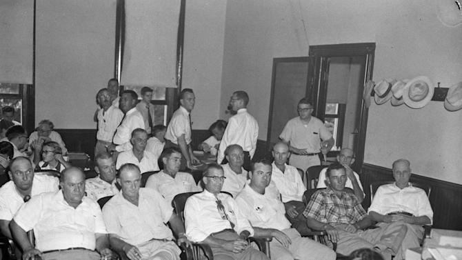FILE - In this Sept. 20, 1955 file photo, jurors sit in a courtroom in Summer, Miss. for the trial of Roy Bryant and J.W. Milam who are charged with the murder of 14-year-old Emmett Louis Till. Acquitted by the all-white jury, the two confessed to the killing of the black teenager in a 1956 Look magazine article. From left in the front row are Gus Ramsey, James Toole, E.L. Price, J.A. Shaw Jr., Ray Tribble and Ed Devaney. In the second row are Travis Thomas, George Holland, Jim Pennington, Davis Newton, Howard Armstrong and Bishop Matthews. (AP Photo/File)