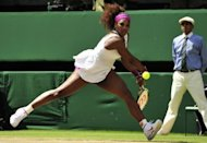 US player Serena Williams plays a double-handed backhand shot during her women&#39;s singles semi-final match against Belarus&#39;s Victoria Azarenka on day 10 of the 2012 Wimbledon Championships tennis tournament at the All England Tennis Club in Wimbledon, southwest London. Williams and Agnieszka Radwanksa will meet in Saturday&#39;s Wimbledon final