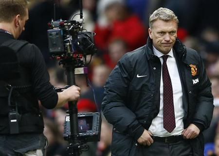 Manchester United's manager David Moyes reacts after losing to Newcastle United in their English Premier League soccer match at Old Trafford in Manchester, northern England, December 7, 2013. REUT