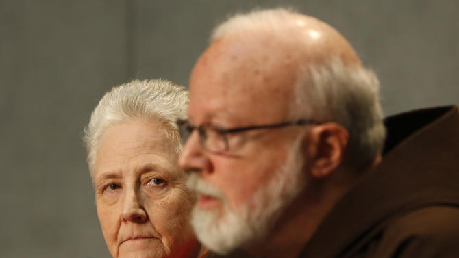 """Cardinal Sean O'Malley, the archbishop of Boston, right, and Marie Collins attend a press conference at the Vatican, Saturday, May 3, 2014. Members of Pope Francis' sexual abuse advisory board say they will develop specific protocols to hold bishops and other church authorities accountable if they fail to report suspected abuse or protect children from pedophile priests. The eight-member committee met for the first time this week at the pope's Vatican hotel to discuss the scope of their work and future members. Briefing reporters Saturday, Cardinal Sean O'Malley, the archbishop of Boston, said current church laws could hold bishops accountable if they fail to do their jobs to protect children. But he said those laws hadn't been sufficiently applied and that """"clear and effective protocols"""" are now necessary.Marie Collins, a committee member and survivor of sexual abuse, said she came away from the inaugural meeting of the commission """"hopeful."""" (AP Photo/Riccardo De Luca)"""