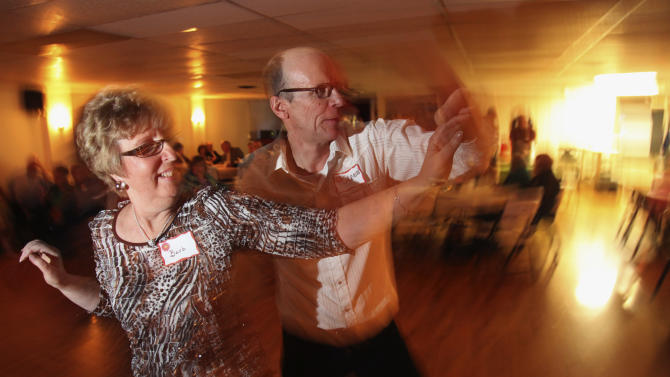 In this April 13, 2013 photo, Glenn Ackeberg, of Lindon, Ill., dances with Barb Ruttledge, of Walnut, Ill., during a Singles in Agriculture social event at the Silver Spur Dance and Reception Hall, in East Moline, Ill. Singles in Agriculture is a group for single farmers seeking a social life or even a spouse. Chapters are active in 11 farm states in the Midwest and West, each of which holds three to six social events a year. (AP Photo/Matthew Holst)