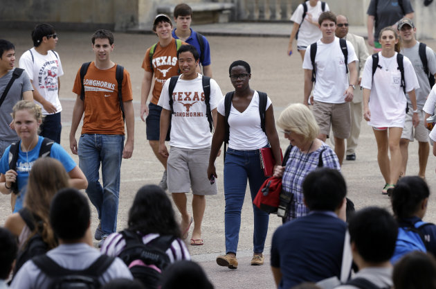 FILE - In this Thursday, Sept. 27, 2012 file photo, students walk through the University of Texas at Austin campus in Austin, Texas. This giant flagship campus - once slow to integrate - is now among the most diverse the country. A decade ago, the U.S. Supreme Court essentially sided with race in that argument, upholding the right of colleges to make limited use of racial preferences in admitting students. But in a ruling due in June 2013, the Court is widely expected to roll back that ruling. Such an outcome would shift the focus more toward giving a boost to socio-economically disadvantaged students, regardless of race. (AP Photo/Eric Gay, File)