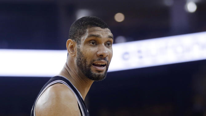 San Antonio Spurs forward Tim Duncan questions a call in the first quarter in Game 6 of a Western Conference semifinal in the NBA basketball playoffs against the Golden State Warriors, in Oakland, Calif., Thursday, May 16, 2013. (AP Photo/Marcio Jose Sanchez)