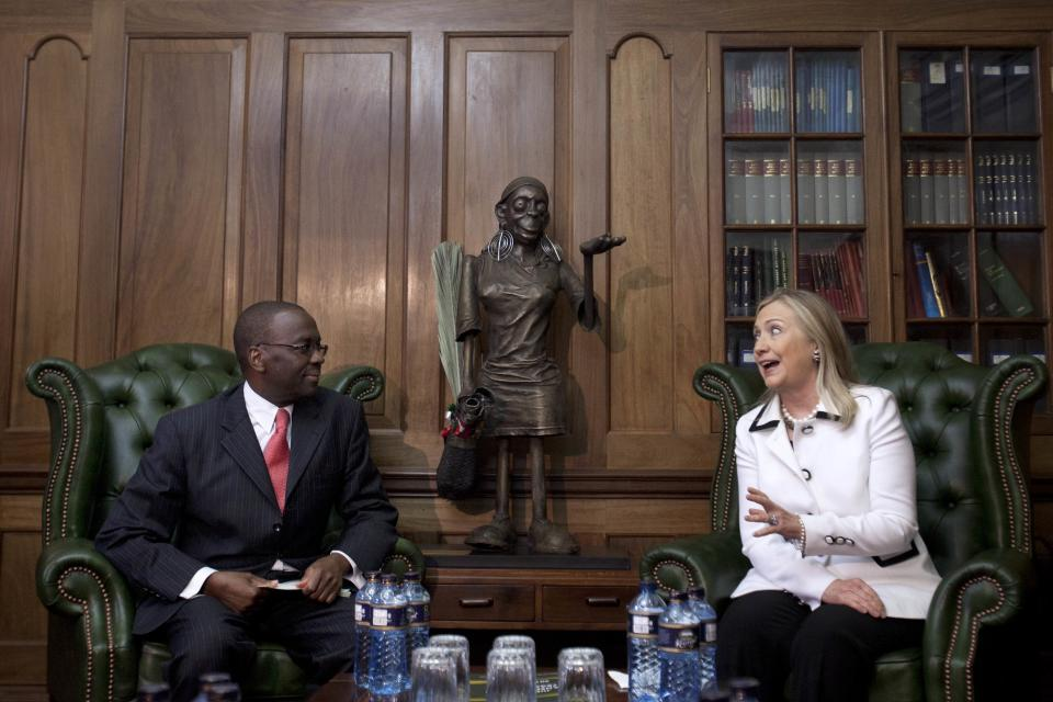 U.S. Secretary of State Hillary Rodham Clinton, right, meets Chief Justice Willy Mutunga at the Supreme Court of Kenya, in Nairobi, Kenya, on Saturday, Aug. 4, 2012. (AP Photo/Jacquelyn Martin, Pool)
