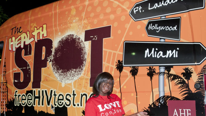 """Lynn Ismael by the """"One Minute HIV test""""  van at the Wilton Manors Out of the Closet (OTC) Block Party & Insti-Test Launch Marking the 5th anniversary of Wilton Manors OTC in Wilton Manors, Florida on Saturday, February 2nd, 2013 at the Hagan Park/City Hall parking lot in Wilton Manors, FL. (Mitchell Zachs /AP Images for AIDS Healthcare Foundation)"""