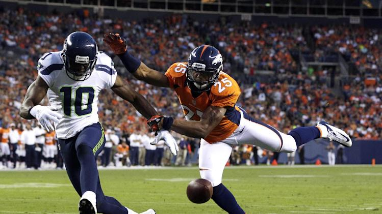 Denver Broncos' Chris Harris (25) breaks up a pass intended for Seattle Seahawks' Terrell Owens (10) in the first half of an NFL football preseason game on Saturday, Aug. 18, 2012, in Denver. (AP Photo/Joe Mahoney)