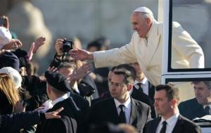 Pope Francis gives blessings as he arrives to lead his Wednesday general audience in Saint Peter's square at the Vatican