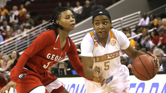 Tennessee's Ariel Massengale (5) takes the ball around Georgia's Tiaria Griffin (3) in the second half of a Southeastern Conference women's tournament NCAA quarter final college basketball game in North Little Rock, Ark., Friday, March 6, 2015. Tennessee defeated Georgia 75-41. (AP Photo/Danny Johnston)