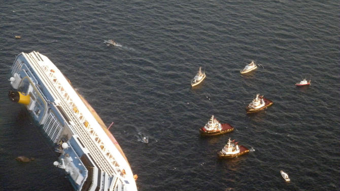 FILE - In this Saturday, Jan. 14, 2012 file photo released by the Guardia di Finanza (border Police), the luxury cruise ship Costa Concordia leans on its side after running aground the tiny Tuscan island of Giglio, Italy. AP Photo/Guardia di Finanza)