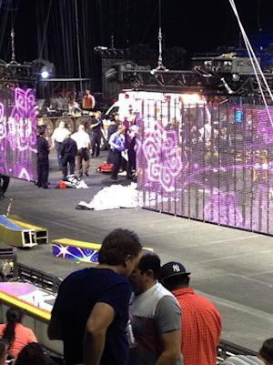 emergency workers tend to injured performers after a platform collapsed, Sunday