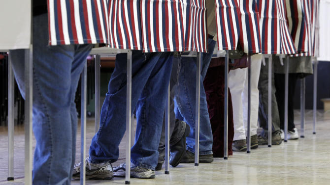 Voters fill the polling booths on Tuesday, Nov. 6, 2012 in Montpelier, Vt.  (AP Photo/Toby Talbot)