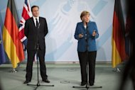 German Chancellor Angela Merkel and British Prime Minister David Cameron address a press conference at the chancellery in Berlin. Merkel pushed for a stronger European political union Thursday amid growing international calls for action as a brutal Spain ratings downgrade added another twist to the eurozone crisis