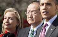 Jim Yong Kim is seen flanked by Secretary of State Hillary Clinton and US President Barack Obama is seen in March as the US nominated him to lead the World Bank. His appointment was announced Monday