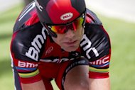 Australia's Cadel Evans rides on the route in a training prior to the start of the 6,4 km individual time-trial and prologue of the 2012 Tour de France cycling race running around Liege, June 2012. Australia cycling coach Matt White said his team planned to take an aggressive approach as they sought to shatter Britain's hopes of early Olympic glory in the men's road race on Saturday