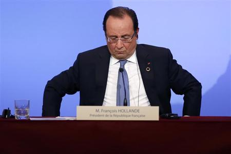 France's President Hollande attends a news conference at the Elysee Palace at the end of the Elysee Summit for Peace and Security in Africa, in Paris