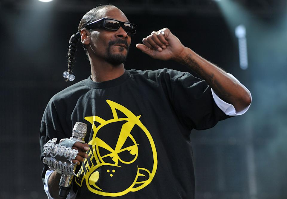 FILE -- In a July 7, 2011 file photo US hip-hop artist Snoop Dogg performs on stage at the Balaton Sound festival in Zamardi, Hungary.  Snoop Dogg is one of the celebrities who have been paid to promote a product on Twitter. (AP Photo/MTI, Tamas Kovacs/file)
