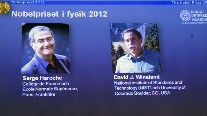 Photographs of the 2012 Nobel Prize laureates in Physics Serge Haroche from France, left, and David Wineland from the US are presented on a screen during a media conference at the Royal Swedish Academy of Science in Stockholm, Sweden, Tuesday Oct. 9, 2012.  Frenchman Serge Haroche and American David Wineland have won the 2012 Nobel Prize in physics for inventing and developing methods for observing tiny quantum particles without destroying them.  (AP Photo/Bertil Enevag Ericson/SCANPIX)   SWEDEN OUT
