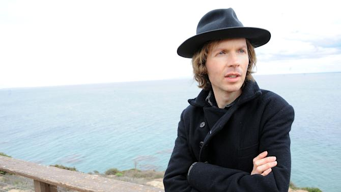 "Musician Beck poses for a portrait at his home on Friday, Dec. 14, 2012, in Malibu, Calif.  Beck Hansen wants you to think about the way music has changed over the last century and what that means about how human beings engage each other these days. Laboring over the intricate and ornate details of his new ""Song Reader"" sheet music project, he was struck by how social music used to be something we've lost in the age of ear buds. (Photo by Katy Winn/Invision/AP)"