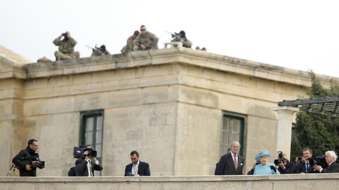 Britain's Queen Elizabeth and Prince Philip look down from bastions towards a harbour during their visit to Villa Bighi in Kalkara, in Valletta's Grand Harbour