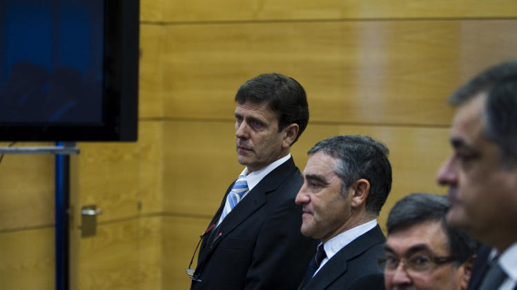 Doctor Eufemiano Fuentes, left, cycling team manager, Manolo Saiz, right, former team manager of Kelme, Vicente Belda, second right, and  trainer José Ignacio Labarta, second left, stand at a court house in Madrid, Spain, Monday, Jan. 28, 2013. The Operation Puerto doping-in-sport trial starts Monday where Judge Julia Santamaria will try six defendants, including doctors Eufemiano and Yolanda Fuentes and Jose Luis Merino, cycling team managers Manolo Saiz and Vicente Belda and trainer Ignacio Labarta. No athlete will sit in the dock, but many must appear as witnesses, including Alberto Contador. The trial ends March 22. (AP Photo/Andres Kudacki)