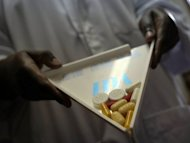 A pharmacist shows antiretroviral drugs on November 30, 2006 in Uganda. What researchers call dormant HIV-infected cells often re-start infections in HIV-infected patients within a few weeks after antiretroviral treatment stops, forcing most people who have tested HIV-positive to stay on the drugs for life or risk the illness progressing