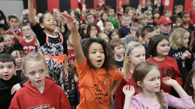IMAGE DISTRIBUTED FOR KEEP AMERICA BEAUTIFUL - Arayla Samuel, first grader, dances with other students after her school, Taylor Primary School, was presented a check as it was announced as the winner of the national Recycle-Bowl K-12 recycling competition in Kokomo, Ind.,Wednesday, Feb. 13, 2013. (AJ Mast /AP Images for Keep America Beautiful)