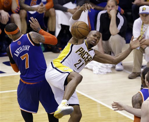 New York Knicks forward Carmelo Anthony, left, and Indiana Pacers forward David West become entangled during the fourth quarter of Game 6 of the Eastern Conference semifinal NBA basketball playoff ser