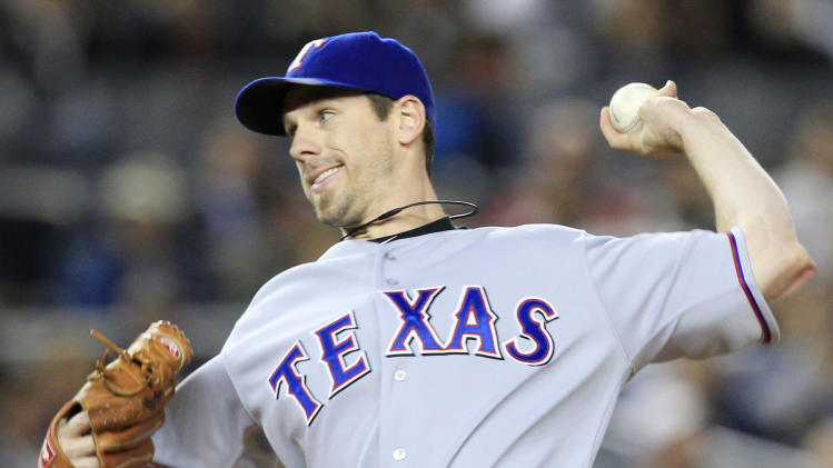 Texas Rangers' Cliff Lee pitches against the New York Yankees in the first inning of Game 3 of baseball's American League Championship Series Monday, Oct. 18, 2010, in New York. (AP Photo/Charles Krupa)