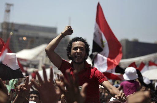 An Egyptian protester chants slogans during the weekly demonstration at Tahrir Square in Cairo, Egypt Friday, July 22, 2011. Protesters were vowing they would not leave the square until Egypt's temporary military rulers purge the remnants of Hosni Mubarak's deposed regime. (AP Photo/Khalil Hamra)