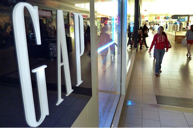 In this May 14, 2012 photo, shoppers walk by the GAP store at a shopping mall in Peabody, Mass.  Gap Inc. is expected to report its earnings Thursday, May 17, 2012. (AP Photo/Elise Amendola)