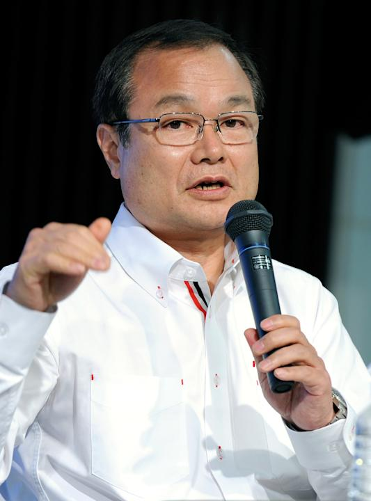 President of Japan's auto giant Takanobu Ito gestures as he answers questions during a press conference at the headquarters in Tokyo on February 3, 2012. Honda announced that it will start taking part